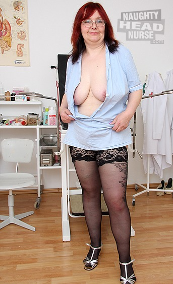 Aged uniformed woman got big natural tits wears nurse uniform and performs a self pussy exam