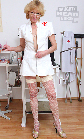 Naughty grandma wears nurse uniform and fingers herself with two fingers then she uses a bizarre gyno tool to open her pussy