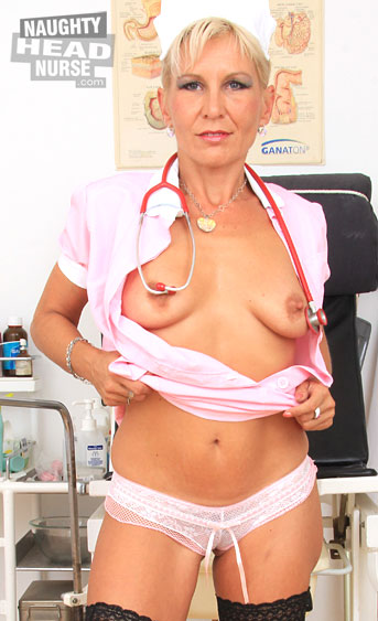 A sexy blonde mature, with a gorgeous body, sexy tits and a tight pink hole does a self pussy exam on herself in sexy pink nurse uniform and stockings