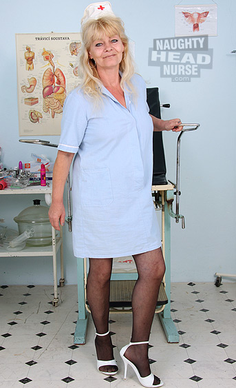 Hot elder milf works as senior nurse in a hospital. She gets horny on gynochair, uses gyno speculum and dildo to toys herself