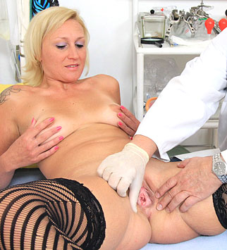 Aged gyn doctor spreads young lily pussy 4