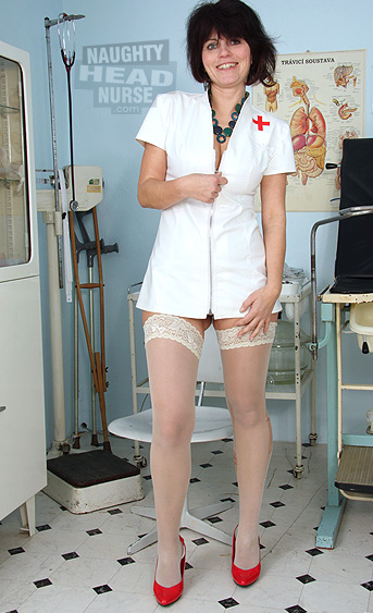 Foxy amateur Milf got big natural boobs and wears latex nurse uniform. She has sexy stockings on her nice legs with red stiletto shoes. She her toying her pussy with a dildo